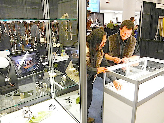 Mathew Nuqingak and Dan Wade of Iqaluit offering their jewelry designs to some of the 2,000-plus delegates at the International Polar Year conference in Montreal this week. (PHOTO BY JANE GEORGE)