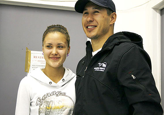 Amanda Eeyeevadluk, 17, stands with NHL star Jordin Tootoo June 30 in Iqaluit. It was Tootoo's last stop on his promotional tour for Norterra and Canadian North, which took him through communities such as Arctic Bay, Pangnirtung, Qikiqtarjuaq, and others. Tootoo flew to Kelowna, B.C., shortly after stopping by Iqaluit, to start off-season training. He becomes an unrestricted free agent July 1, which means any NHL team may speak to him about signing a contract. (PHOTO BY DAVID MURPHY)