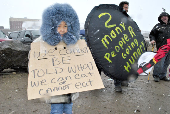 Little Simeonie Willougby of Iqaluit at a June 9 food price protest across the street from the Northmart store in Iqaluit. (PHOTO BY JIM BELL)