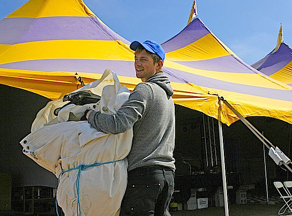 Will Hyndman helps set up June 29 inside Alianait Art Festival's purple and yellow big-top tent. The Iqaluit festival, which kicks off June 29 with an art exhibit at the Nunatta Sunakkutaangit Museum, also features workshops, concerts, exhibits, and numerous activities and shows throughout the weekend before wrapping up on July 2. The opening concert, featuring Esther Powell & the Roughcuts, Saali, the Jerry Cans, and Ann Vriend, starts at 7 p.m. in Nakasuk School's gym. Admission is $18 for adults, $8 for youth aged 13 to 18, and free for elders. (PHOTO BY DAVID MURPHY)