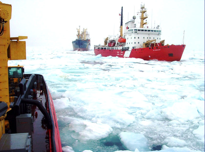 The Canadian Coast Guard Ship Des Groseilliers escorts the NSSI cargo ship Anna Desgagnés through heavy ice pack in Frobisher Bay July 26. The Coast Guard vessels Des Groseilliers  and Terry Fox have spent days battling ice to safely bring the cargo ships Anna Desgagnés and Qamutik, operated by NEAS, into Iqaluit. The Coast Guard is now preparing to help a variety of ships get out of Iqaluit. The Terry Fox also succeeded in removing a dangerous buoy from Koojesee Inlet this week. (PHOTO COURTESY OF ENVIRONMENT CANADA)