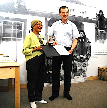 Cambridge Bay MLA Keith Peterson presents Annie Neglak with the Council of the Federation Literacy Award at the May Hakongak Community Library and Cultural Centre in Cambridge Bay on Aug. 27. (PHOTO COURTESY OF THE GOVERNMENT OF NUNAVUT)