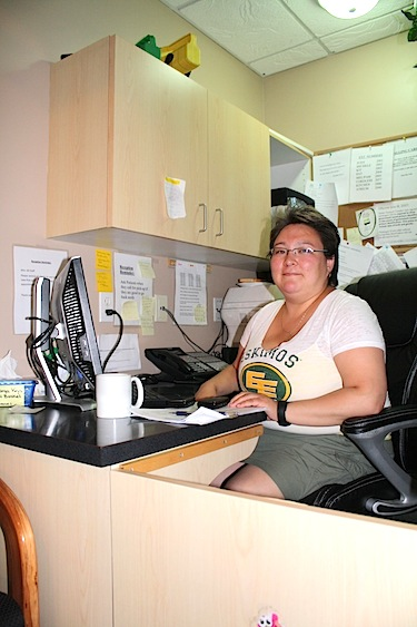 Kimberly Tolognak, 37, receptionist and dispatcher for Larga Edmonton. Originally from Cambridge Bay, Tolognak has spent eight years in Edmonton, but still loves working with people from the North. (PHOTO BY ANGELA BRUNSCHOT)
