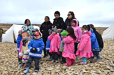 Children from Cambridge Bay's child care centre sing for passengers from The World on Aug. 30. (PHOTO BY PAUL BILLOWES/ KITIKMEOT HERITAGE SOCIETY)