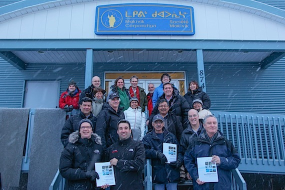 Representatives from Nunavik, Nunatsiavut and the ArcticNet research network stand outside the Makivvik Corp. office in Kuujjuaq where the report,