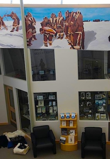 The finished mural overlooks the ground floor of the May Hakongak Library and Cultural Centre in Cambridge Bay. (PHOTO COURTESY OF THE KITIKMEOT HISTORICAL SOCIETY)
