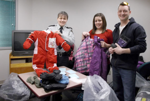 "Cpl. Yvonnne Niego of the RCMP's ""V"" division community policing section, with two GN workers in Iqaluit, organizing the first shipment of Nunavut snowsuits that local Iqaluit agencies will give out to needy residents. It's part of a charity effort called the Nunavut Snowsuit Fund, based in Ottawa, that gathers donations of warm outerwear for Nunavut residents who can't afford to buy expensive winter clothes. ""One recipient was receiving help to get their life back on track and was starting a new job, but with recent cold weather was in need of a warm coat and boots to get to and from home and work. The package reached the organization the day this person really needed them to start their new career,"" Niego said. Those who wish to donate to the Nunavut Snowsuit Fund may email Nunavutsnowsuitfund@hotmail.com, or drop off donations at Larga Baffin, 1071 Richmond Rd. or MacKinnon's Foodland in Greely. The fund also has a Facebook page. (PHOTO COURTESY OF THE RCMP)"