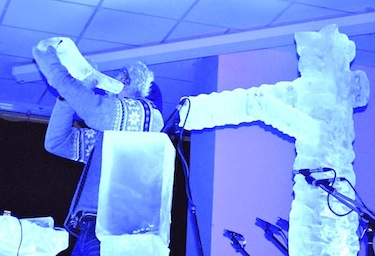 Ice musician Terje Isungset plays one of his ice horns at his Feb. 19 concert at Iqaluit's Inuksuk High School. (PHOTO BY JANE GEORGE)
