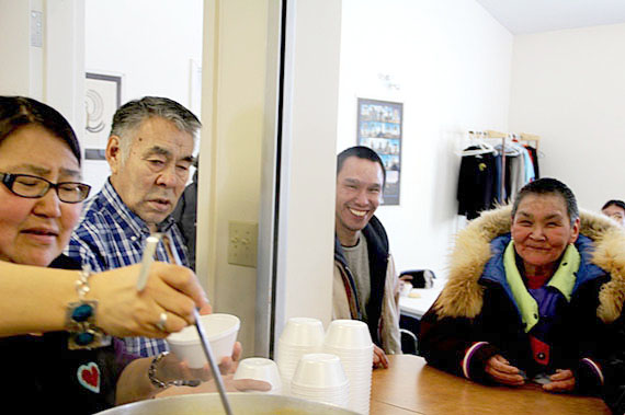 Nattlik MLA Jeannie Ugyuk serves up soup alongside Akulliq MLA John Ningark at Iqaluit's Qayuktuvik soup kitchen Feb. 28. Iqaluit West MLA Monica Ell, the Nunavut minister responsible for homelessness, invited MLAs to lunch at the soup kitchen as a way of drawing attention to the