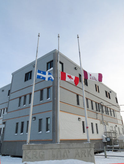 Flags from Quebec, Canada and the Kativik Regional Government were lowered to half-mast March 4 at the KRG office in Kuujjuaq in honour of Cst. Steve Dery of the Kativik Regional Police Force, who was shot and killed March 2 when he and another member of the KRG-run police force responded to a call about a domestic dispute. (SUBMITTED PHOTO)