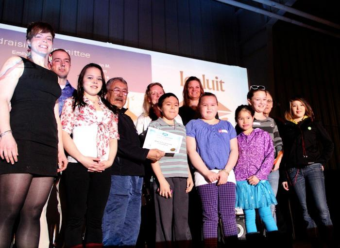 Volunteers with the Iqaluit Reach campaign accepted an award for volunteer appreciation from Coun. Kenny Bell, Coun. Simon Nattaq and Mayor John Graham, at the curling rink April 26 during the city's volunteer appreciation awards ceremony. (PHOTO BY SAMANTHA DAWSON)