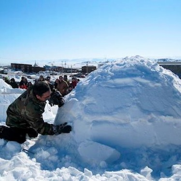 Joe Netser puts the finishing touches on his igloo  April 13 during the igloo-building contest, part of Toonik Tyme's annual events. Netser completed his snow house in just 35 minutes, beating more than six others to win the contest.