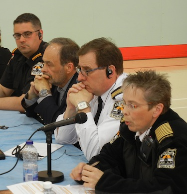 Kativik Regional Police Force chief Aileen MacKinnon, right,  speaks May 29 to the Kativik Regional Government regional council meeting in Kangiqsujuaq. (PHOTO BY JANE GEORGE)