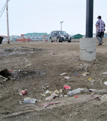 With the arrival of spring, litter and garbage have re-emerged from melting snow in Iqaluit, as shown here in Iqaluit Square in the city centre. City councillor Terry Dobbin says one-time spring clean-ups are not enough to keep streets and public places clean. (PHOTO BY PETER VARGA)