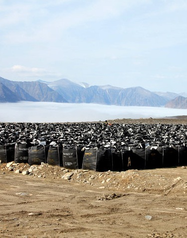 Clean-up work at Nunavut's Distant Early Warning sites will start again this June. Here's a look at about 6,500 metric tonnes of bagged PCBs and other hazardous waste waiting for shipment out of Qikiqtaaluk Logistics' Cape Dyer remediation site last year. (FILE PHOTO)