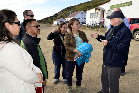 Doug Cunningham, the CEO of Arctic Fibre, discusses his company's project with Iqaluit city councilor Mary Wilman and other municipal officials Aug. 19 at the Apex beach, where they viewed the company's proposed cable landing spot. (PHOTO BY JIM BELL)