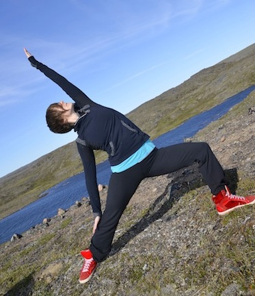 Christine Lamothe practices yoga outside her home on the Road to Nowhere in Iqaluit. (PHOTO BY DAVID MURPHY)