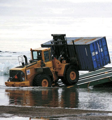 In an undated file photo, a forklift lifts a crate at the sealift beach in Iqaluit. (FILE PHOTO)