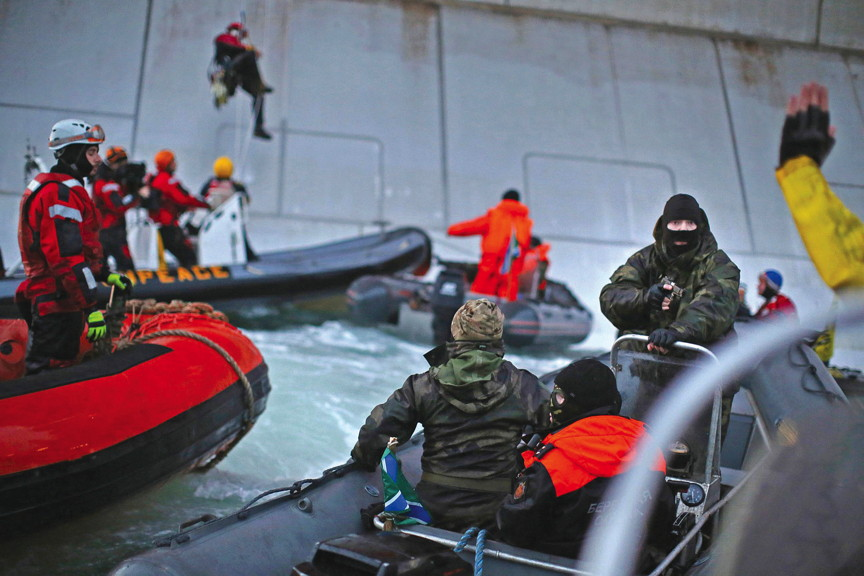 Greenpeace protesters getting arrested as they attempt to board the Gazprom Arctic oil platform. (FILE PHOTO)