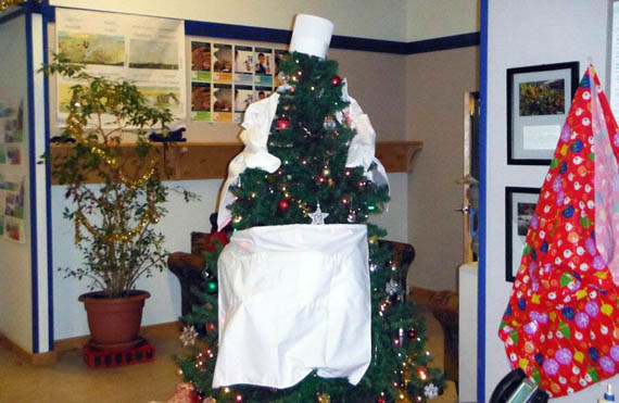 Staff and students at the Nunavut Arctic College campus in Cambridge Bay got a start to the holiday season by decorating their holiday tree like a culinary student, dressed in a chef's hat and apron. Culinary arts is one of the programs hosted at that community's NAC campus. (PHOTO COURTESY OF NAC)