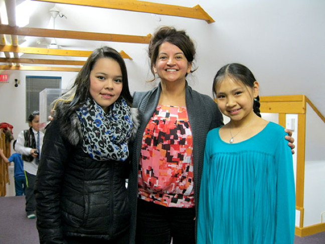 Nalini Vaddapalli, administrator of the Nunavut Law Foundation, with two of the territory's seven recipients of this year's Upinnaqtuq Awards, which the foundation gives annually to youth who demonstrate