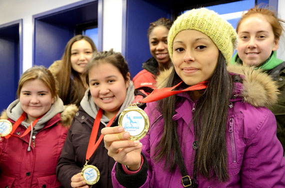 At the Iqaluit airport, Amabel Mora (bottom right) displays the gold medal she won with her teammates at the Snowball Invitational basketball tournament this past weekend in Montreal. The Iqaluit Ravens, comprised of (from top left to bottom right) Kristen Kownak, Mary Omole, Alexia Galloway-Alainga, Lexie Baillargeon and Lindsey Eelee, only had one substitute for the entire tournament, but beat out three other teams to earn first place. (PHOTO BY DAVID MURPHY)