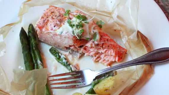 Arctic Char in parchment paper cooks fish and any other vegetables encased in an air-tight shell. (IMAGE COURTESY OF FOODWISHES.COM)