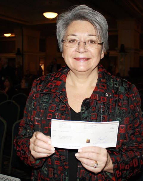 Mary Simon, chair of ITK's National Committee on Education, with the $325,000 cheque the organization received Dec. 11 as part of ArticNet's Arctic Inspiration Prize. ITK will use the money to promote parental involvement in schools throughout the four Inuit regions of the Canadian Arctic. (PHOTO COURTESY OF ITK)