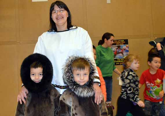 Kindergarten Inuktitut teacher Lena Ipeelie poses with her students Duncan Mearns and Igimaq Williamson Bathory Jan. 31, when the staff and students at Joamie Ilinniarvik school took part in a traditional clothing day. (PHOTO BY SONJA LEBLANC)