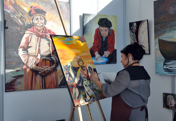 Innu artist Mary Ann Penashue from Sheshatshiu, Labrador works on an oil painting from her booth at the Northern Lights business and cultural showcase in Ottawa Jan. 31. This year's event has attracted 200 exhibitors from across Nunavut, Nunavik and Nunatsiavut. (PHOTO BY SARAH ROGERS)