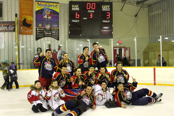 Members of Team Iqaluit pose with their gold medals March 2 after winning the 2014 Avataq Tournament in Rankin Inlet. The 13-member team went undefeated in all of their six games during the weekend tournament, eventually beating Repulse Bay 6-3 in the final. Iqaluit took a 4-1 lead in the first period, and kept Naujat back by a margin of at least two goals for the rest of the game. Iqaluit's Sateanna Goupil netted two goals and assisted on two others, earning first star of the game honours. Repulse Bay's Jamie Malliki earned second star for scoring twice. (PHOTO COURTESY OF NOEL KALUDJAK)