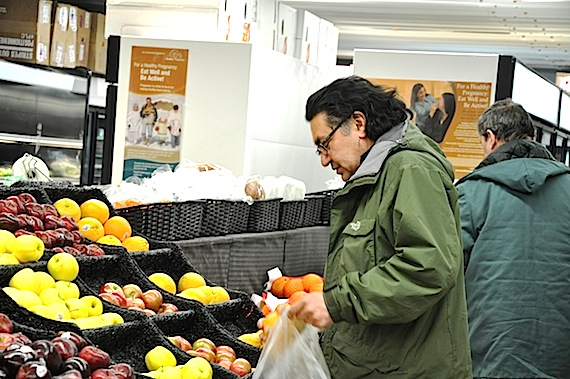 NDP MP for Nunavik, Romeo Saganash, is seen here checking food prices in Kuujjuaq during the 2011 federal election campaign. Saganash says the new federal budget delivers few measures to create jobs and help families in his riding. (FILE PHOTO)