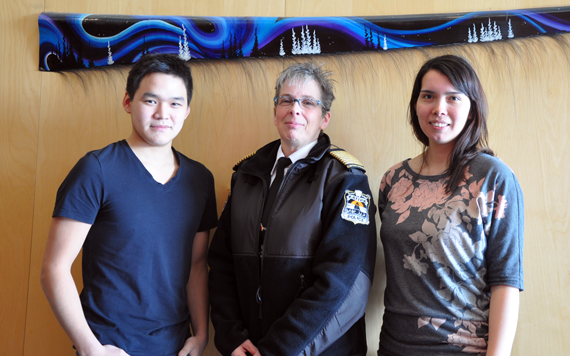Kativik Regional Police Force chief Aileen MacKinnon, centre, poses with her newest staff members; Anthony Arreak, left, the force's new public relations and community liaison worker, and Tracy Partridge, its new crime prevention officer. Both Kuujjuaq-based staffers were hired in January, to help grow the KRPF's presence in communities across Nunavik. (PHOTO BY SARAH ROGERS)