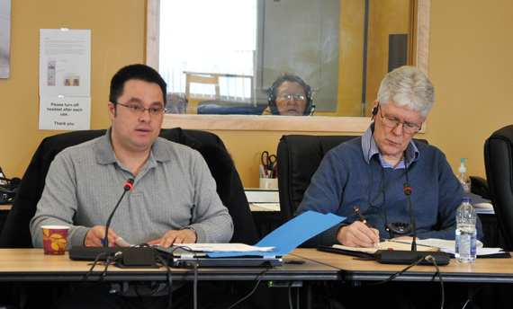 At left, George Berthe, interim president of the Kativik Municipal Housing Bureau, with the bureau's director Watson Fournier at right, speak to the Kativik Regional Government's regional council Feb. 27. (PHOTO BY SARAH ROGERS)