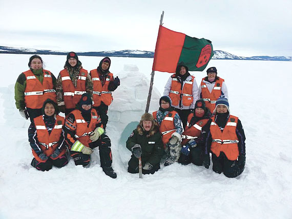 Nunavut elder Piita Irniq, originally from Repulse Bay and now residing in Ottawa, poses for a photo with some junior rangers near Rigolet, Labrador after an iglu-making workshop. This is the third time the Nunatsiavut Government has hired Irniq to do culture and healing workshops, which include iglu-making, carving and ulu-making, as well as residential school healing sessions. Visit Piita Irniq's Facebook page to see what he's been up to in Nunatsiavut. (PHOTO COURTESY PIITA IRNIQ)