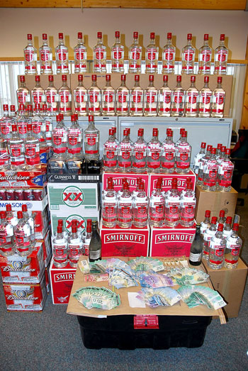 A big inventory of beer and Smirnoff vodka seized in Iqaluit by police in March 2010, when four Iqaluit men were charged with keeping liquor for sale illegally. The men had acquired the booze legally, but intended to sell it illegally. (FILE PHOTO)