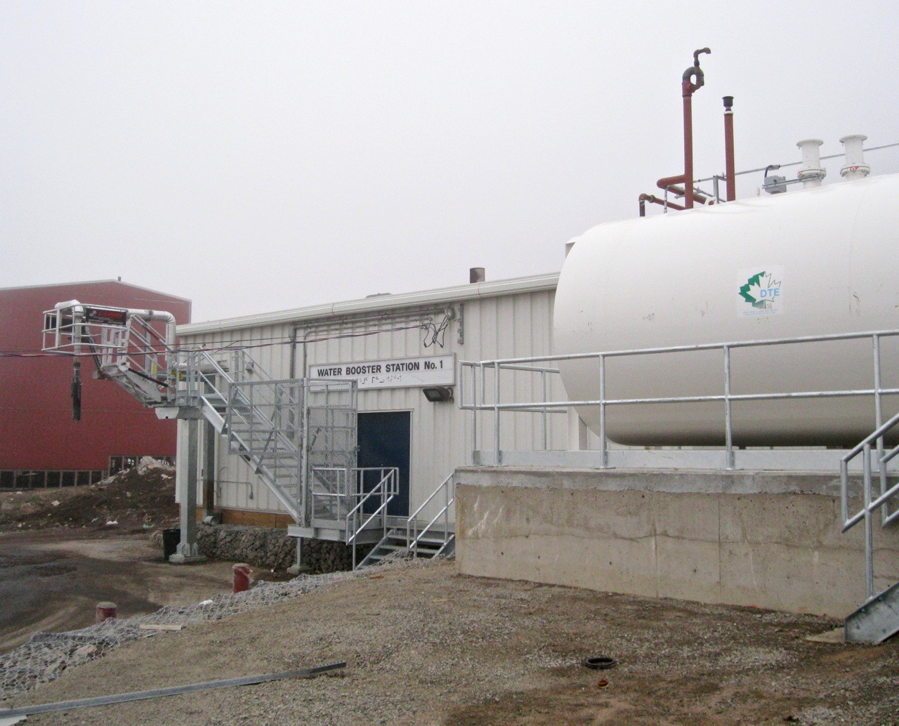 The city of Iqaluit's water booster station, pictured, feeds the city with water which meets federal and territorial government standards, but the wastewater flowing out into Koojesse Inlet does not. The city must upgrade its sewer and solid waste facilities to renew its water license, which expired in 2012. (PHOTO BY PETER VARGA)