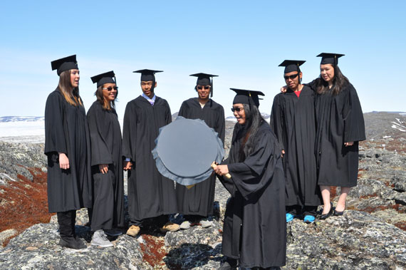 Pending exams and term 3 assignments, these are the 2014 graduates from Kangiqsualujjuaq's Ulluriaq school, posing in their gowns near Ungava Bay last week. From left: Andrea Brazeau, Eileen Emudluk, Donald Etok, Nicolas Annanack, Maasa Ittulak on the drum, Traugott Annanack and Julia St. Aubin. High school students across Nunavik are gearing up for graduation ceremonies later this month. (PHOTO BY MCCOMBIE ANNANACK)
