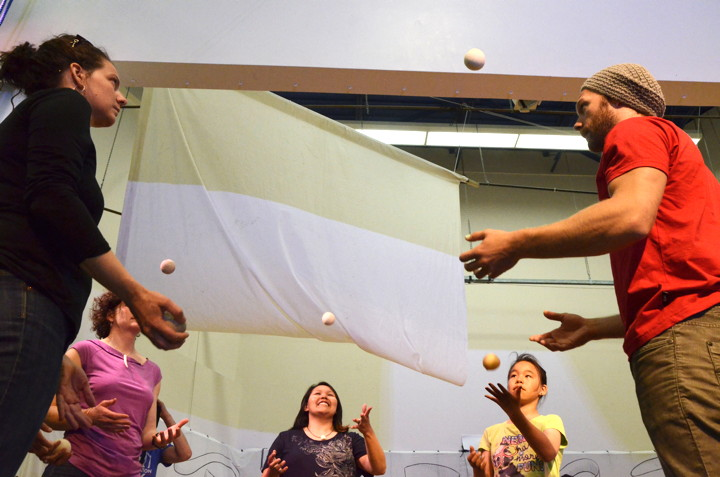 Participants at a free June 29 circus workshop at Nakasuk School try to keep the balls in the air. (PHOTO BY DAVID MURPHY