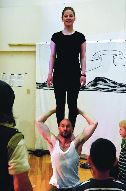 Guillaume Saladin, performer, trainer and co-founder of Artcirq — Igloolik's travelling acrobatic circus clan — holds a participant from the June 29 circus workshop on his shoulders at Nakasuk School in Iqaluit. (PHOTO BY DAVID MURPHY)