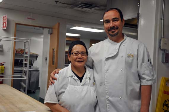 Veteran cook-help Betty Matautuaaq with Meadowbank's first cook Eric Laurent St-Louis in the mine site's kitchen June 23. (PHOTO BY SARAH ROGERS)