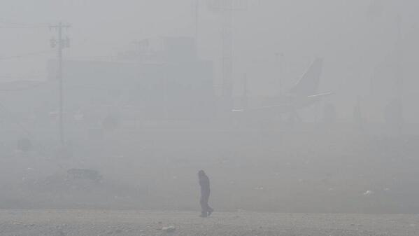 Johnny A. Ugjuk snapped this photo of someone walking past the airport in Rankin Inlet June 25 after a change in wind direction sent smoke from the nearby dump fire over that part of town, severely reducing visibility. (PHOTO BY JOHNNY A UGJUK)