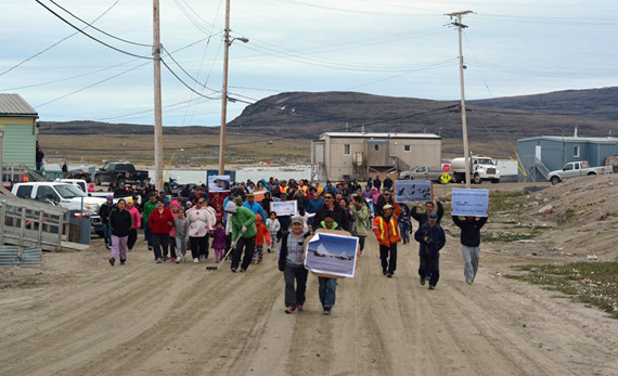 More than 100 people who took to the streets of Clyde River — and in Arctic Bay — this past July 23 to protest the National Energy Board's approval of seismic testing in Baffin Bay and Davis Strait. (FILE PHOTO)