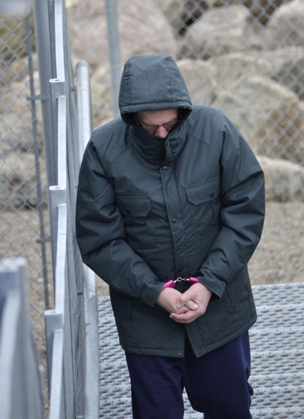 Eric Dejaeger, on May 26, being lead into the Nunavut Court of Justice in Iqaluit. (FILE PHOTO)