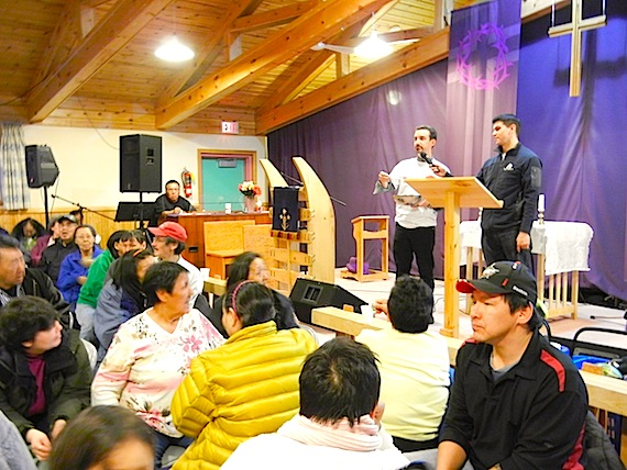 Dr. Gonzalo Alvarez, the Ottawa researcher behind the Taima TB campaign, and Franco Buscemi of Nunasi Corp., call out the names of door prize winners after a community feast sponsored by Nunavut Tunngavik Inc. at the Anglican parish hall held March 22, 2012. During the feast, which attracted about 500 people, Alvarez presented the project's results and, to thank people for their participation in the project, drew out names for prizes, which included items like a tool box, a basket brimming with a selection of healthy food and a box of caribou meat. (PHOTO BY JANE GEORGE)