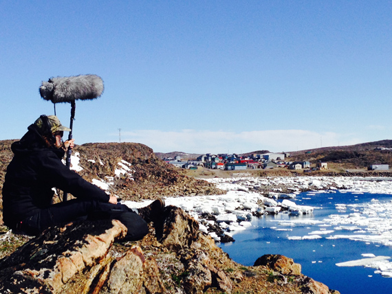 The film's sound recordist gathers audio from the outskirts of Quaqtaq last June. (PHOTO BY LAURA RIETVELD)