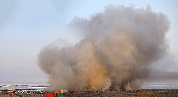 Rankin Inlet's fire department extinguished a minor fire at the hamlet's dump Aug. 11. The flare-up was the fourth time flames have broken out at the site since the dump's last major fire, pictured, which brought thick smoke into the community earlier this summer. (FILE PHOTO)