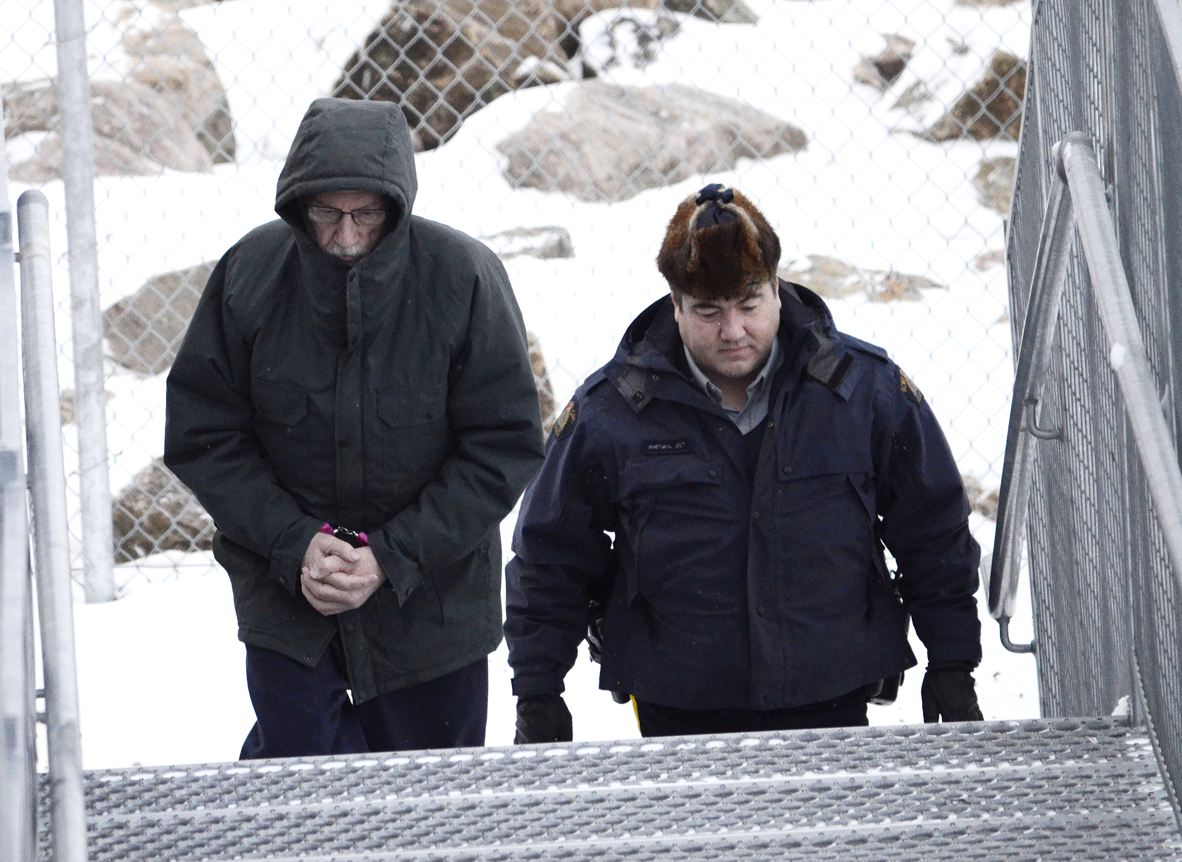 Eric Dejaeger is led into the Iqaluit courthouse building at a court appearance late last year. (FILE PHOTO)