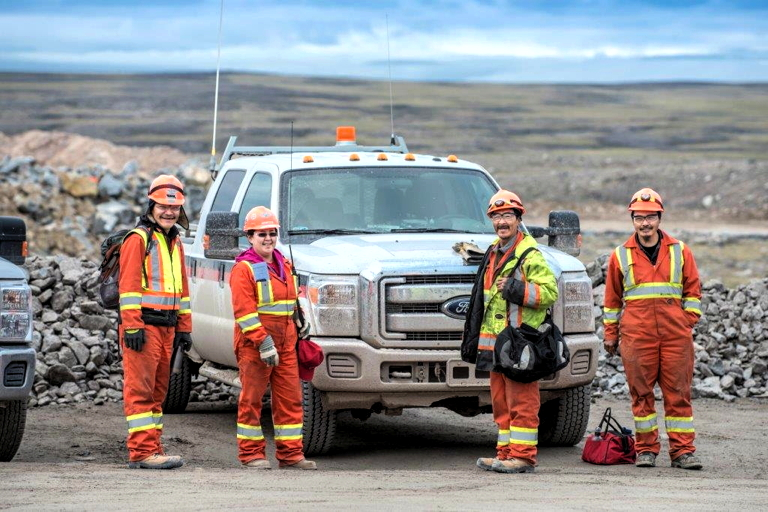 A group of Baffin-based workers stands near the site of Baffinland Iron Mines' Mary River mine site about 160 km southwest of Pond Inlet. While the company has made test shipments in the past, on Sept. 8 it transported the mine's first official load of iron ore to its port site at Milne Inlet and boasted in a recent news release that after years of planning and regulatory hurdles,