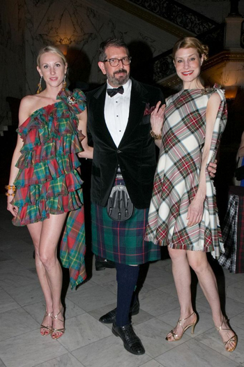 Canadian designer Michael Kaye, centre, with models wearing some of his tartan gowns. (PHOTO COURTESY OF MICHAEL KAYE)